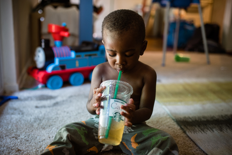 boy drinks tea from to go cup -Documentary Family Photography
