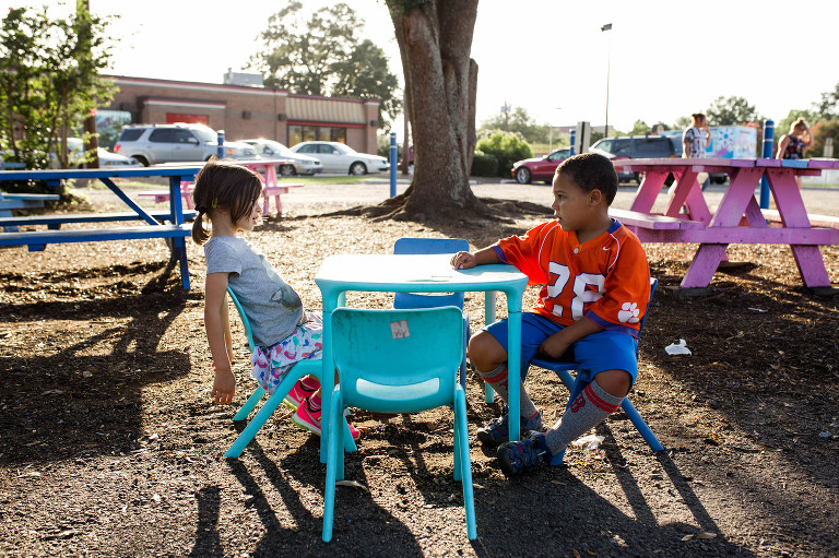kids chat at picnic table - Documentary Family Photography