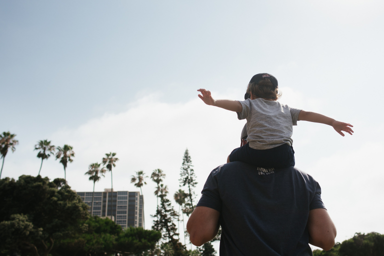 boy on father's shoulders - Documentary Family Photography