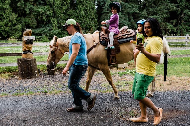 child on horseback - Documentary Family Photography
