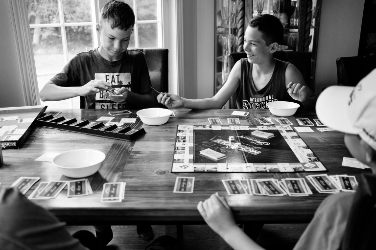kids play board game - Documentary Family Photography