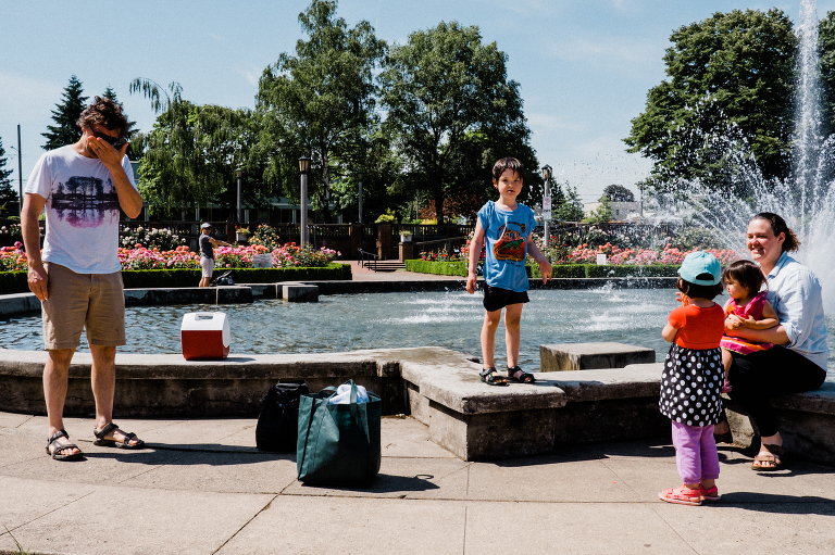 wet child at fountain - Documentary Family Photography