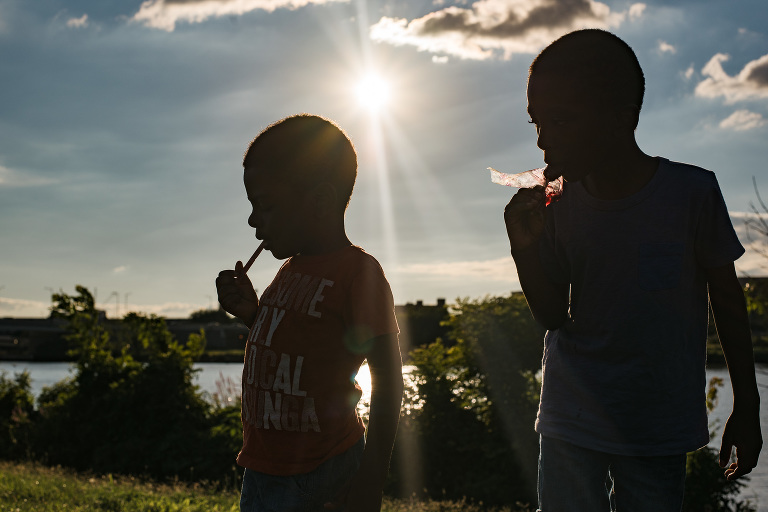 silhouette of kids near lake - documentary family photography