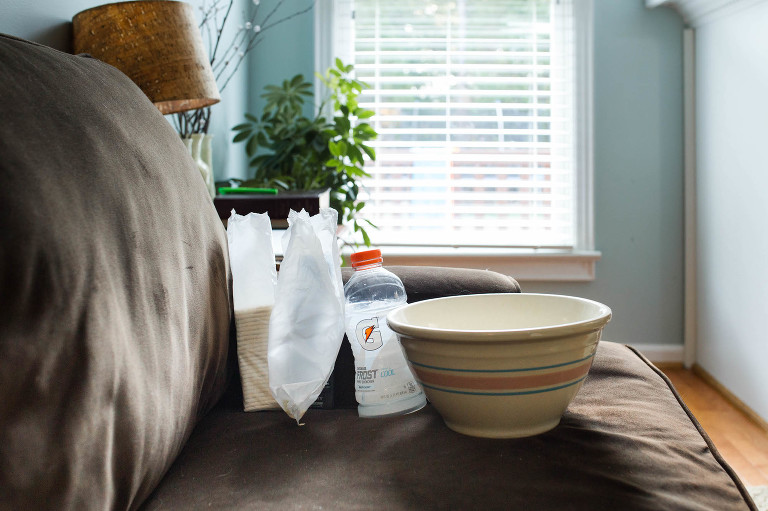 dishes left on couch - documentary family photography