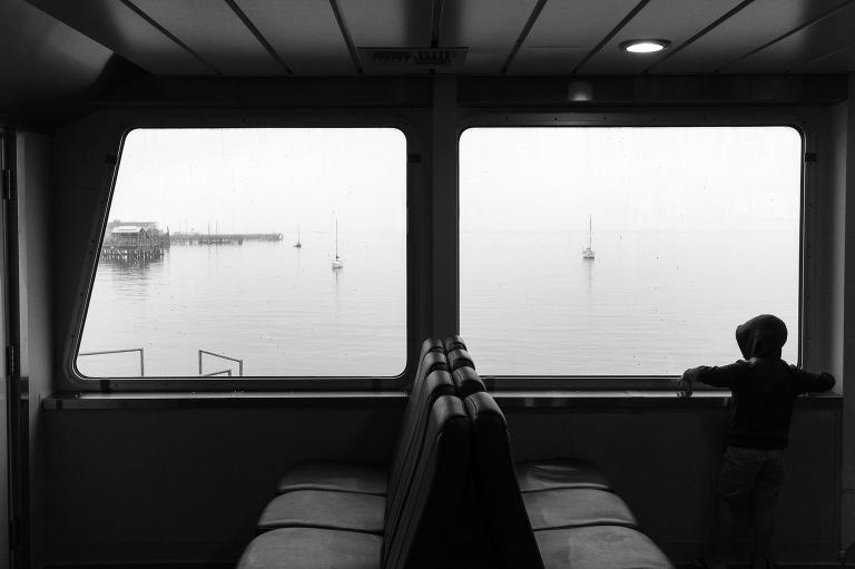 boy on ferry - documentary family photography