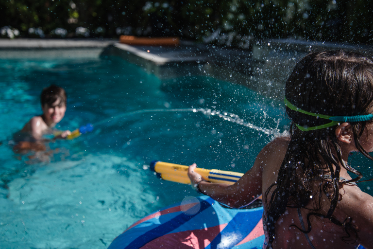 kids play in pool - documentary family photography