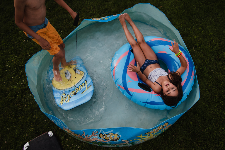 kids in kiddie pool - Documentary Family Photography