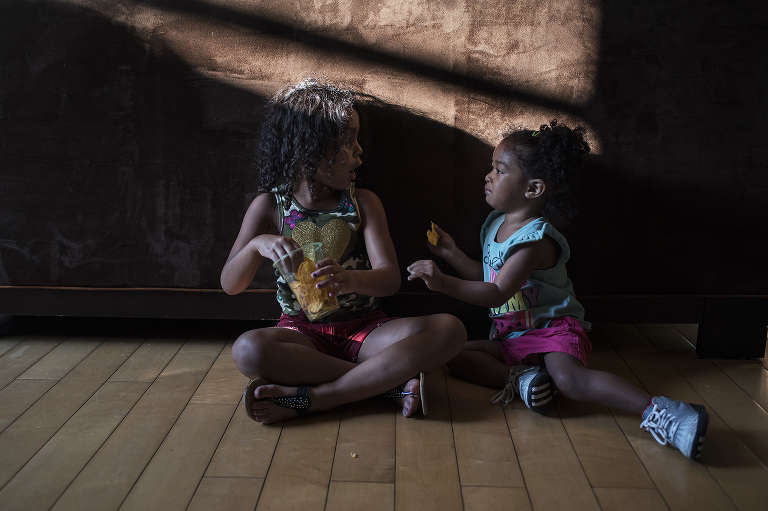 girls sitting in shadow - Documentary Family Photography