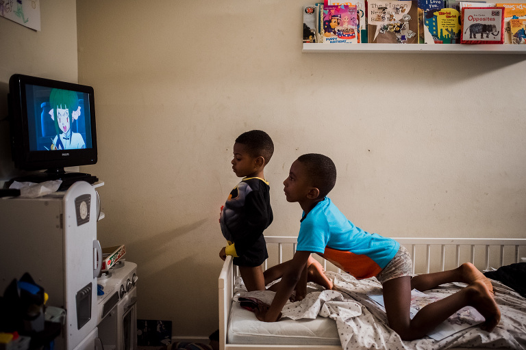 boys watch television - Documentary Family Photography