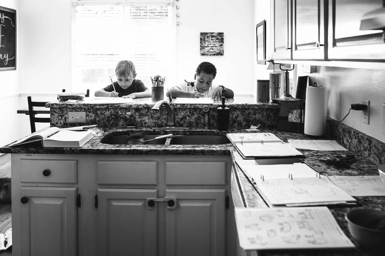 boys do homework in kitchen - Documentary Family Photography