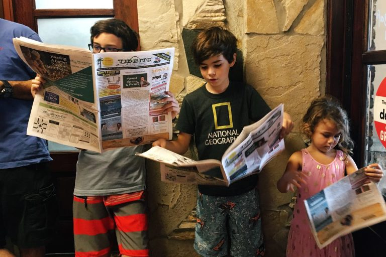 kids reading news paper - Documentary Family Photography