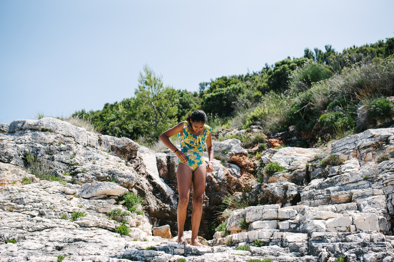 girl on cliff in swimsuit - Documentary Family Photography