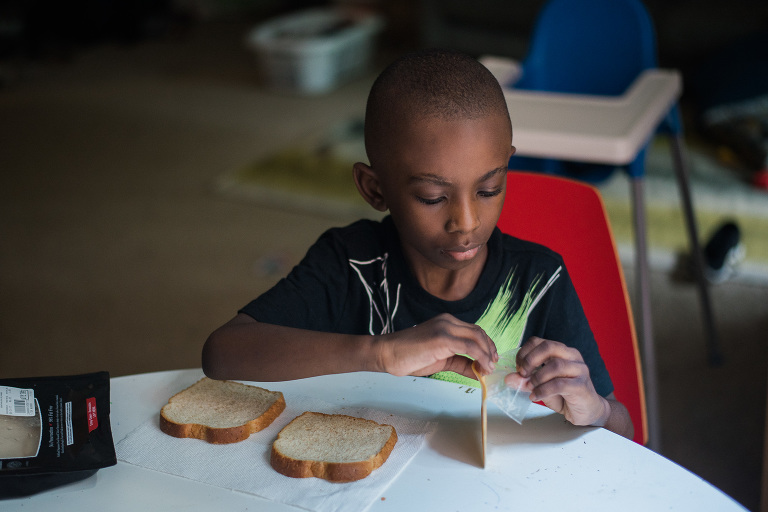 child making sandwich - documentary family photography