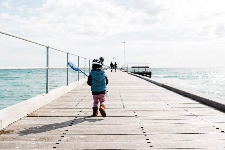 child on dock - documentary family photography