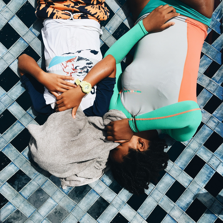 girls laying in sunshine - documentary family photography