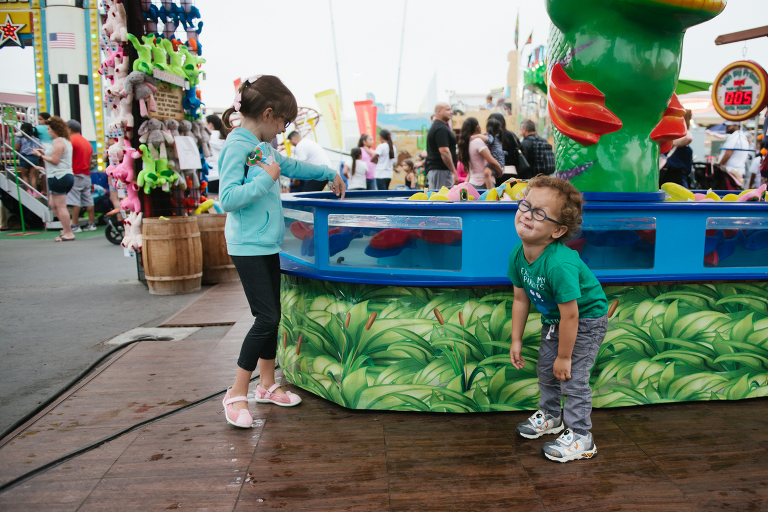 kids at fair counter - documentary family photography