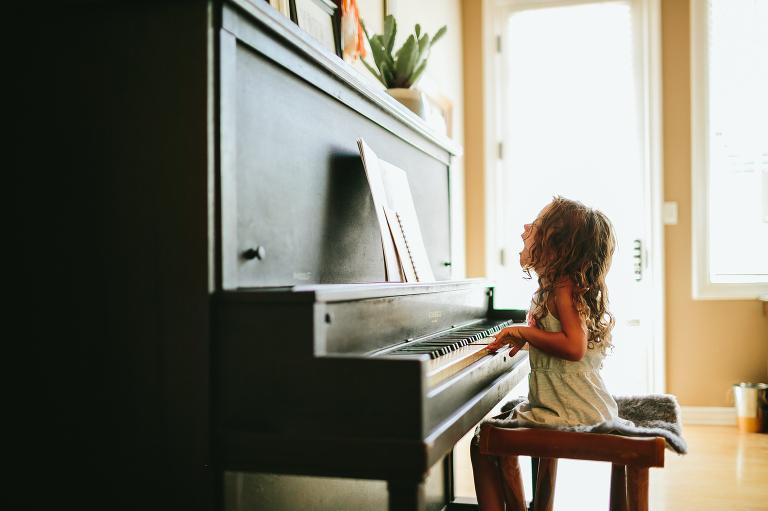 child at piano - documentary family photography