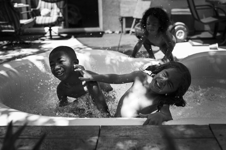 kids playing in wading pool - documentary family photography