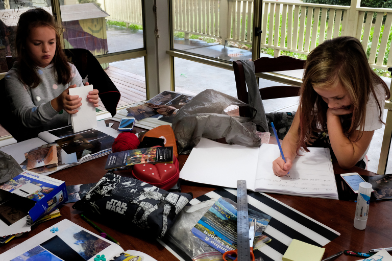 kids doing work at table - documentary family photography
