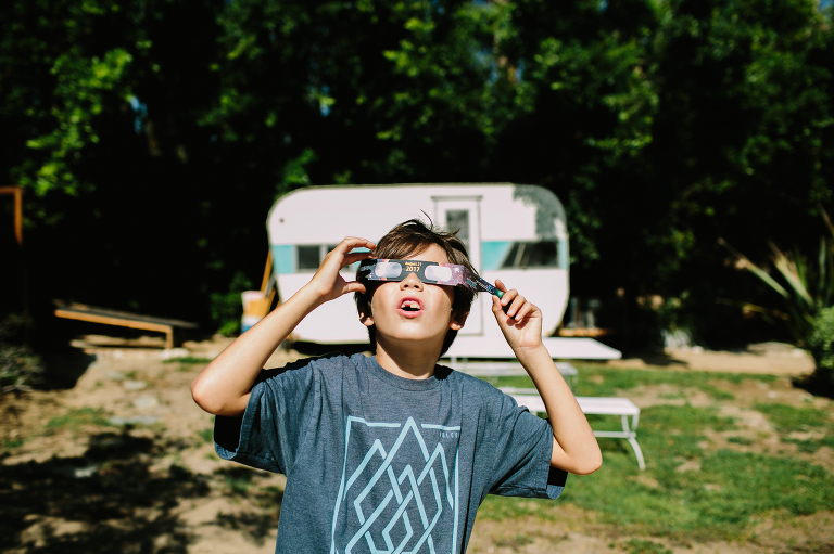 boy with eclipse glasses - documentary family photography