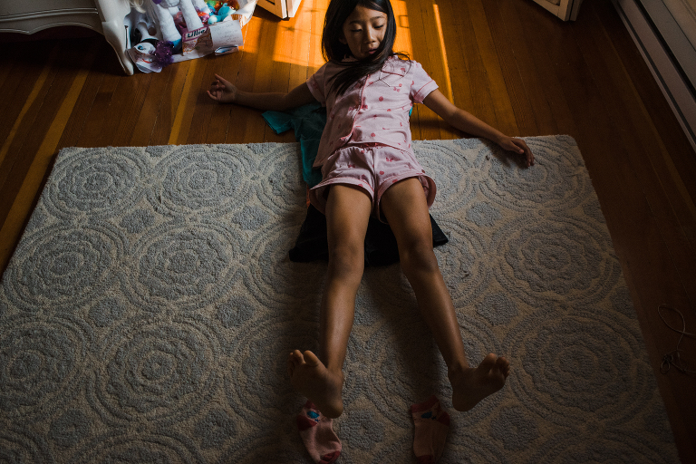 girl laying on floor - Documentary Family Photography