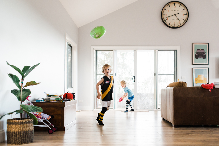 kids play ball in house -Documentary Family Photography