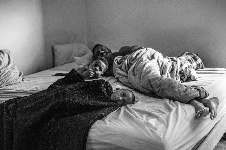 family lounges in bed - Documentary Family Photography