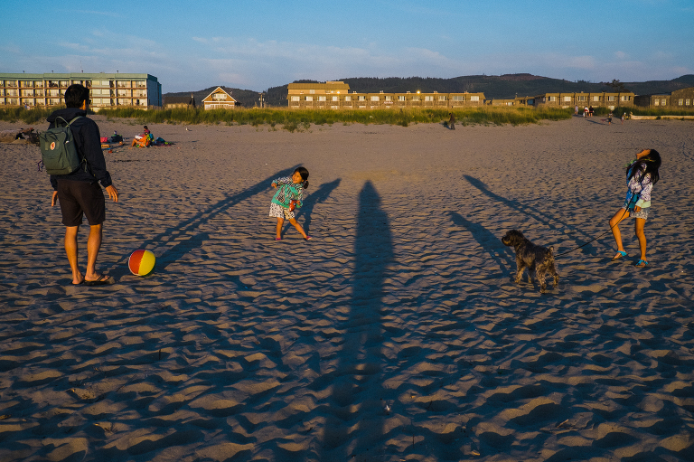 family with long shadows on beach - Documentary Family Photography