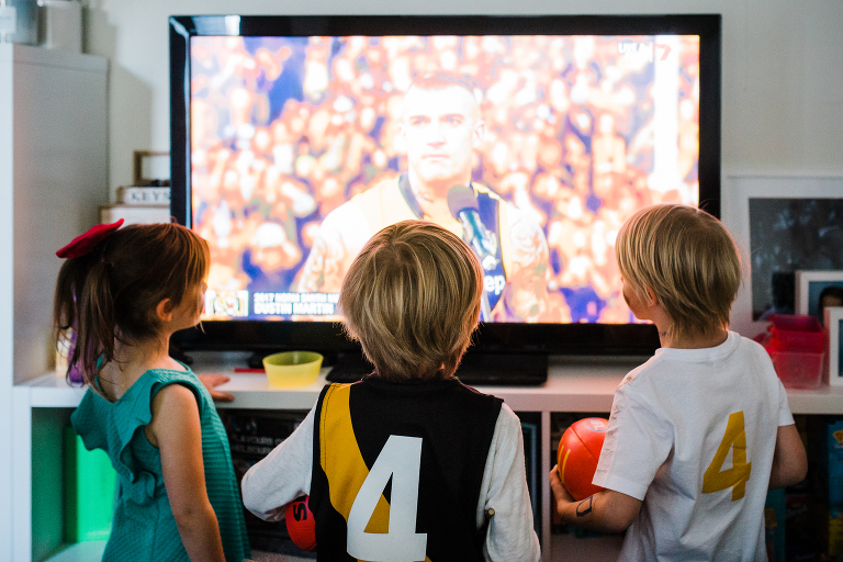 kids watching sports on TV - Documentary Family Photography
