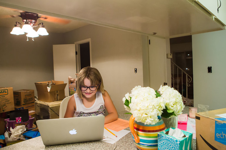 girl at laptop in kitchen - documentary family photography