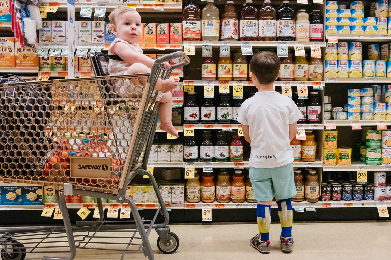 kids at grocery store - documentary family photography