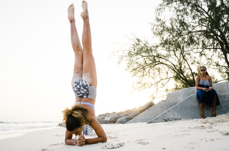 girl doing forearm stand on beach - documentary family photography
