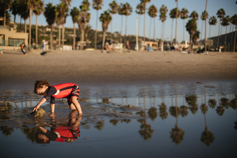 boy and reflection on shore - documentary family photography