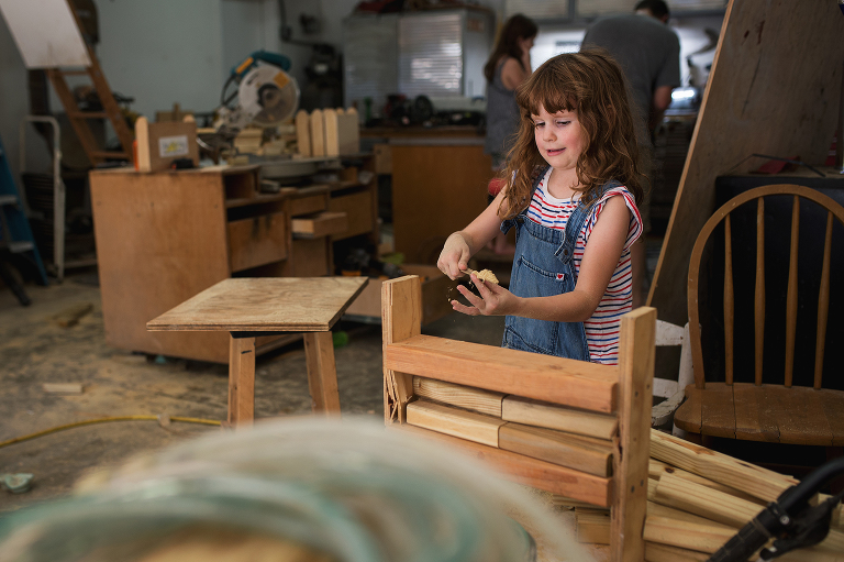 girl with woodwork - Documentary Family Photography