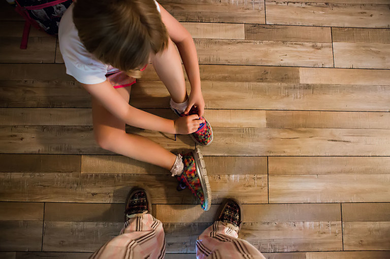 child puts on shoes - Documentary Family Photography