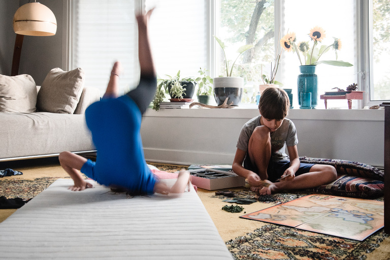 kids playing on floor in living room - Documentary Family Photography
