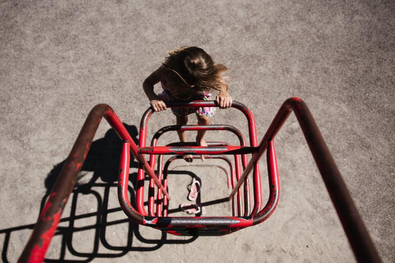 kid climbing playground - Documentary Family Photography