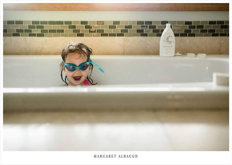 girl with goggles in tub - Documentary Family Photography