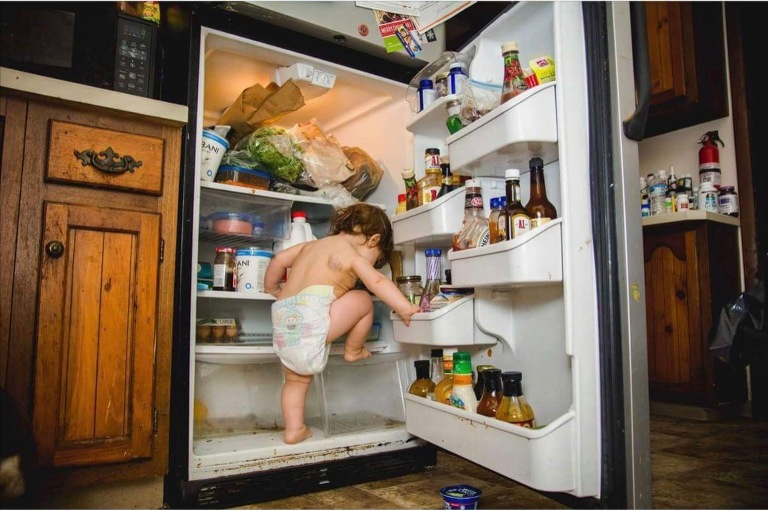child in fridge - Documentary Family Photography