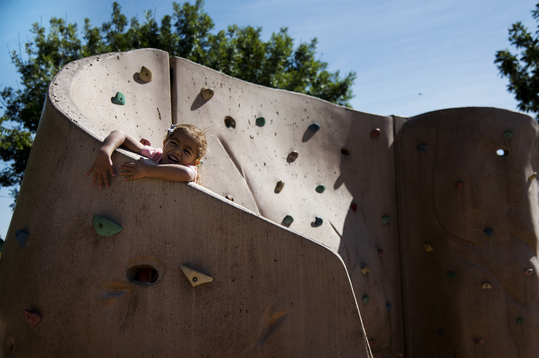 kid on climbing wall - documentary family photography