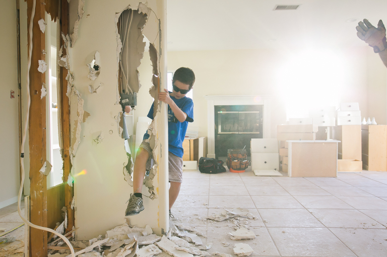 boy helps wth home remodel - documentary family photography