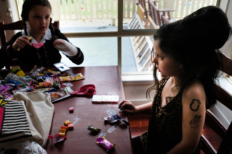 kids with Halloween candy - documentary family photography