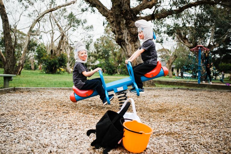 boys on seesaw - documentary family photography