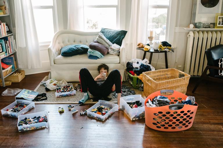 boy on floor amidst legos - documentary family photography