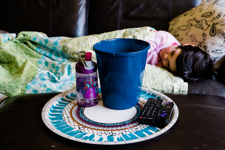 girl with sick bucket -documentary family photography