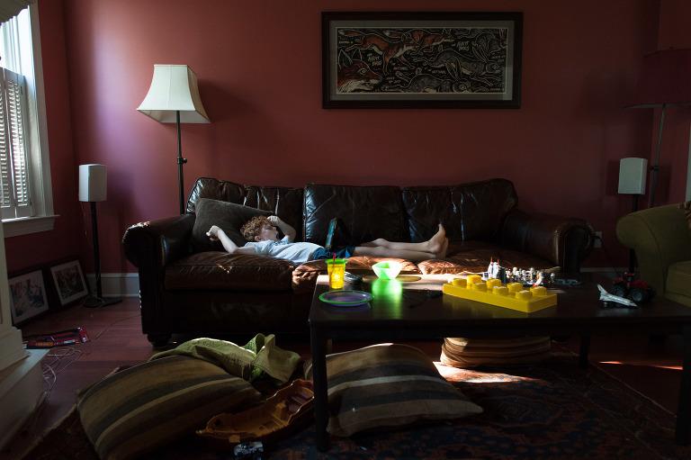 boy asleep on couch - documentary family photography
