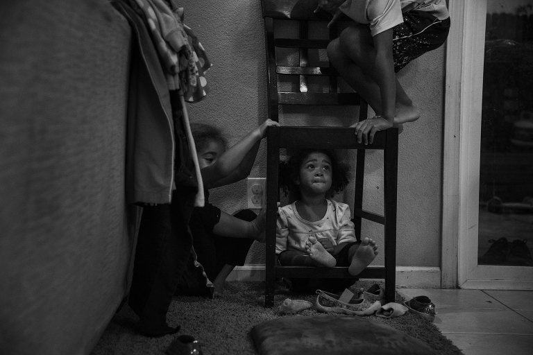 kids climbing on chair in kitchen - documentary family photography