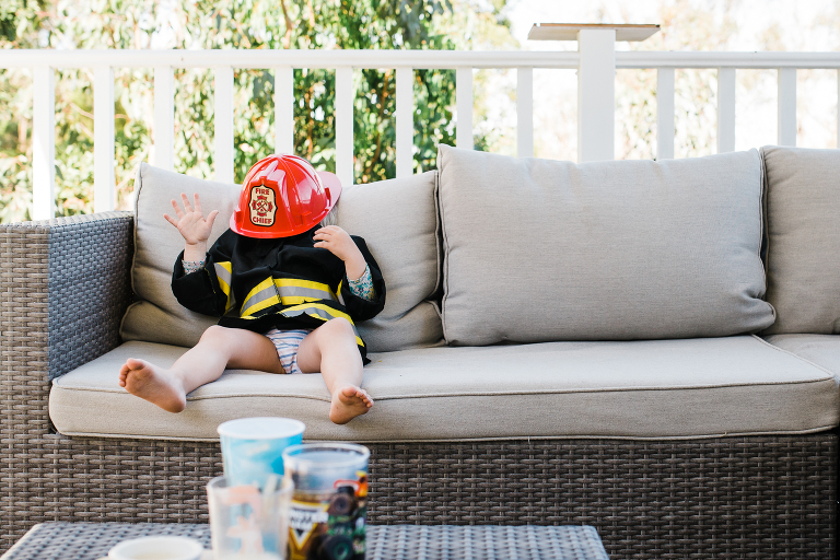 kid in fireman outfit - documentary family photography
