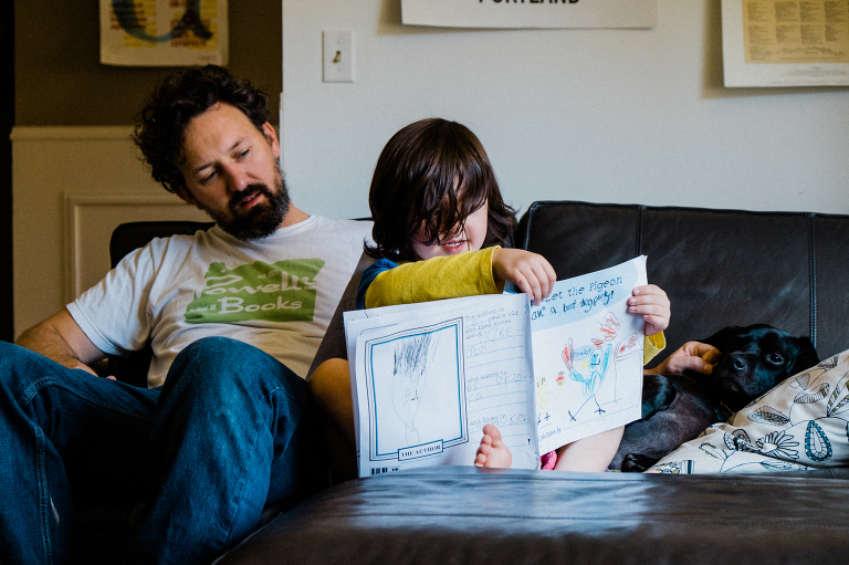 boy with father and workbook - documentary family photography