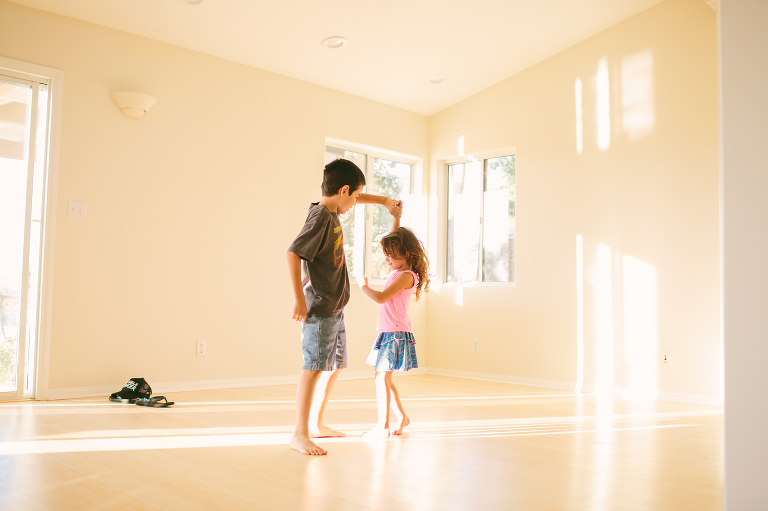 kids dancing in empty room - documentary family photography